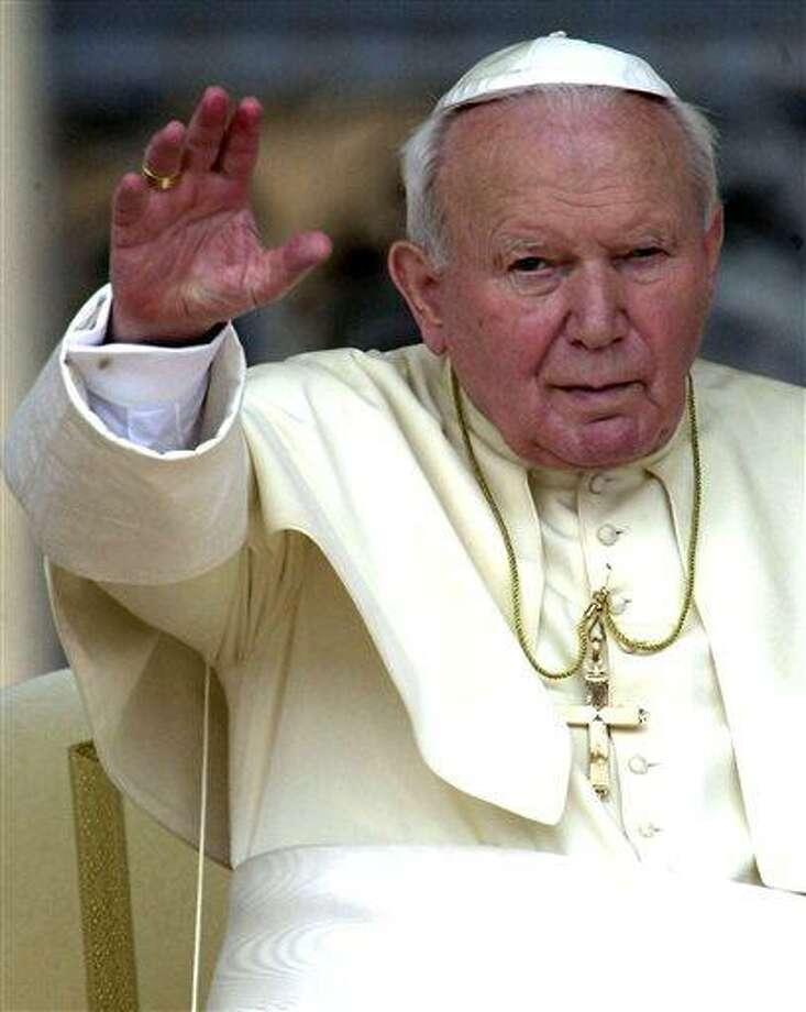 FILE - In this May 2, 2001 file photo, Pope John Paul II waves to faithfuls gathered for the weekly general audience at St. Peter's Square in the Vatican. A Vatican official on Wednesday, June 19, 2013, said a commission of theologians approved a miracle attributed to his intercession, moving the Polish-born pope closer to sainthood. (AP Photo/Plinio Lepri, File) Photo: AP / AP