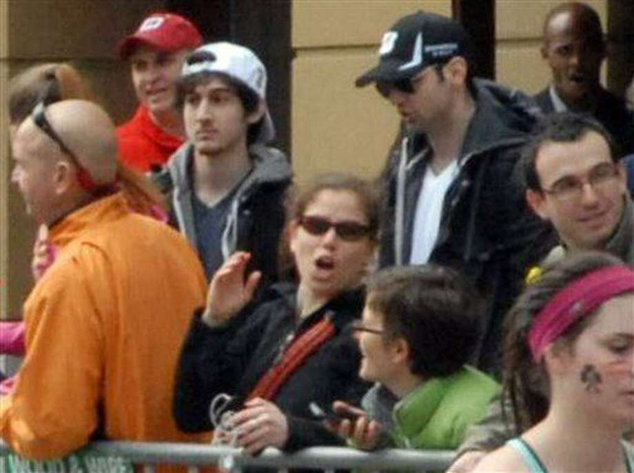 This Monday, April 15, 2013 photo provided by Bob Leonard shows bombing suspects Tamerlan Tsarnaev, 26, center right in black hat, and his brother, Dzhokhar A. Tsarnaev, 19, center left in white hat, approximately 10-20 minutes before the blasts that struck the Boston Marathon. It's a vexing puzzle about the Boston Marathon bombings: The younger of the two accused brothers hardly seemed headed for a monumental act of violence. How could he team up with his older brother to do this? Nobody knows for sure, but some experts in sibling research say the powerful bonds that can develop between brothers may have played a role. (AP Photo/Bob Leonard) Photo: AP / Bob Leonard
