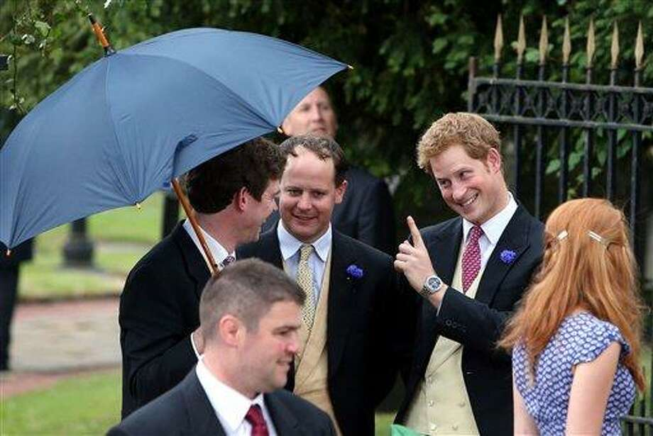 Britain's Prince Harry, right, leaves after attending the wedding of the Duke and Duchess of Northumberland's daughter Lady Melissa Percy to chartered surveyor Thomas van Straubenzee at St Michael's Church in Alnwick, England, Saturday, June 22, 2013. (AP Photo/Scott Heppell) Photo: AP / AP