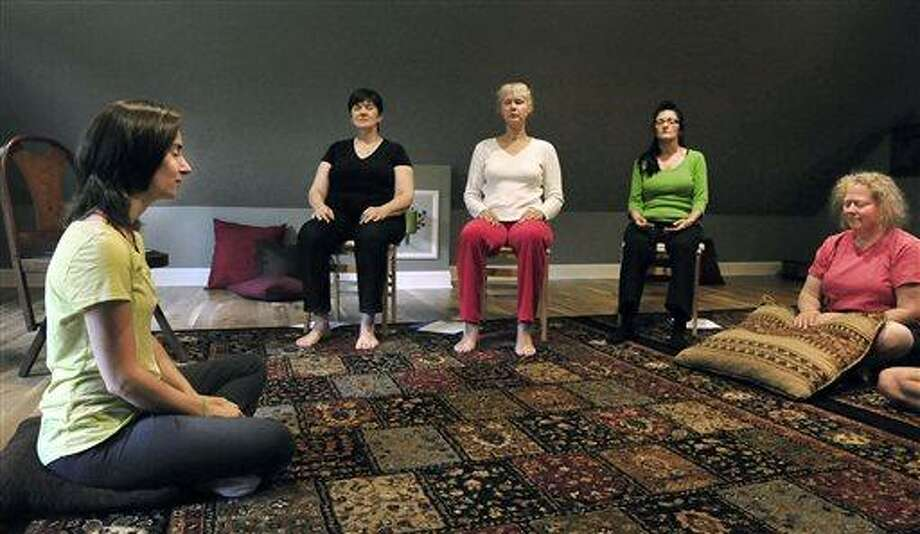 AP MEMBER FEATURE EXCHANGE ADVANCE FOR JULY 7 - In this June 16, 2013 photo, teacher Rachel Andrews leads a class in psychic development for beginners at Sound, an alternative arts center in Newtown, Conn. Sound's offerings include everything from meditation groups and music therapy to women's empowerment classes, intuitive drawing, and private music lessons. (AP Photo/The News-Times, Michael Duffy) MANDATORY CREDIT Photo: AP / Danbury News-Times