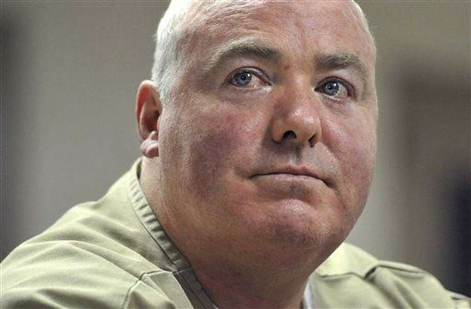 In this Wednesday, Oct. 24, 2012 file photo, Michael Skakel listens during a parole hearing at McDougall-Walker Correctional Institution in Suffield, Conn.  Skakel will be in Rockville Superior Court in Vernon, Conn., Tuesday, April 16, 2013, appealing his 2002 conviction of murdering Martha Moxley in Greenwich in 1975.  Skakel's attorney will argue his trial attorney's poor performance likely affected the verdict. (AP Photo/Jessica Hill, Pool) Photo: AP / FR125654 AP
