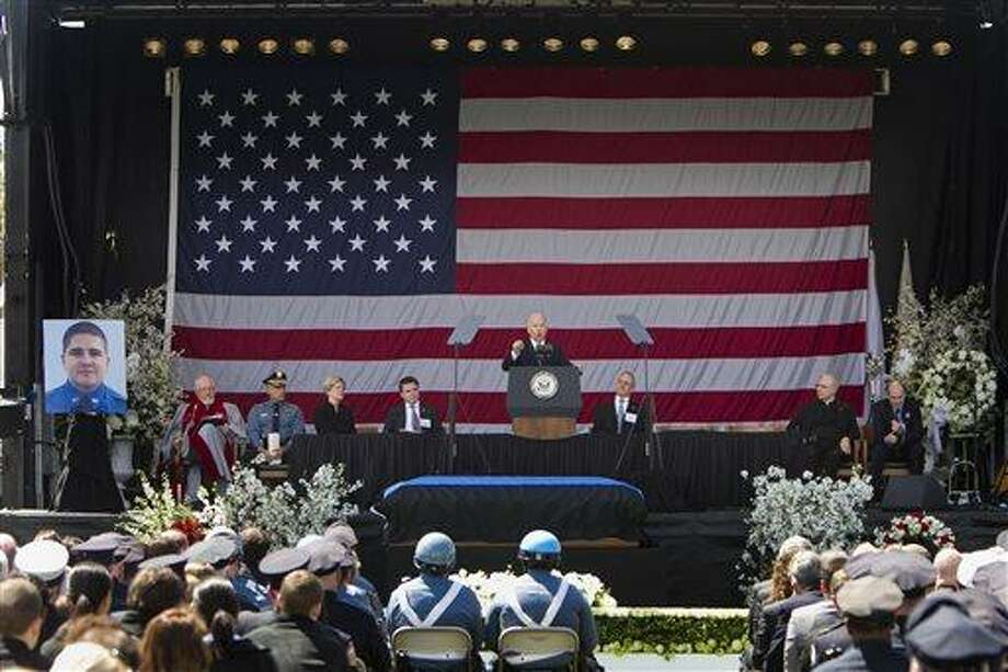 In a photo provided by Massachusetts Institute of Technology, U.S. Vice President Joe Biden speaks during a memorial service for fallen MIT police officer Sean Collier on the MIT campus in Cambridge, Mass., Wednesday, April 24, 2013. Collier was fatally shot on campus Thursday, April 18, 2013. Authorities allege that the Boston Marathon bombing suspects were responsible. (AP Photo/Massachusetts Institute of Technology, Dominick Reuter) Photo: AP / Massachusetts Institute of Technology