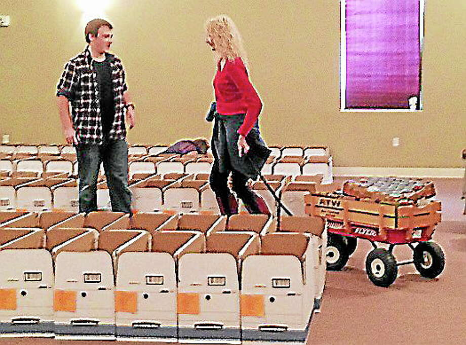 More than 100 volunteers joined Project Thanksgiving in the past few days to assemble the boxes for pick up on Tuesday. Photo: Kaitlyn Schroyer - The Middletown Press