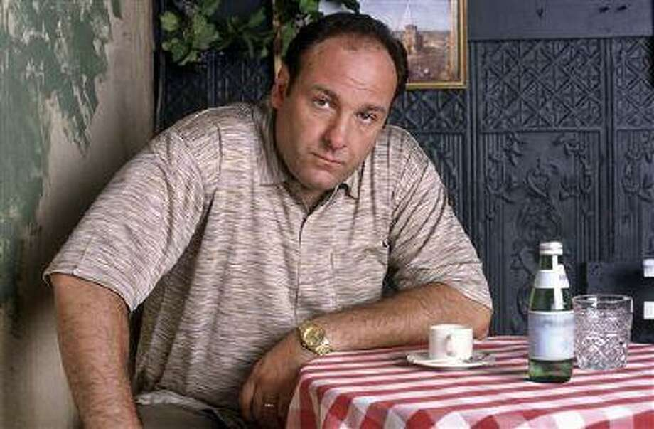 """This 1999 photo provided by HBO, shows James Gandolfini as mob boss Tony Soprano, in an episode from the first season of the HBO cable television mob series, """"The Sopranos."""" HBO and the managers for Gandolfini say the actor died Wednesday, June 19, 2013, in Italy. He was 51. (AP Photo/HBO, Anthony Neste/File) Photo: ASSOCIATED PRESS / A2007"""