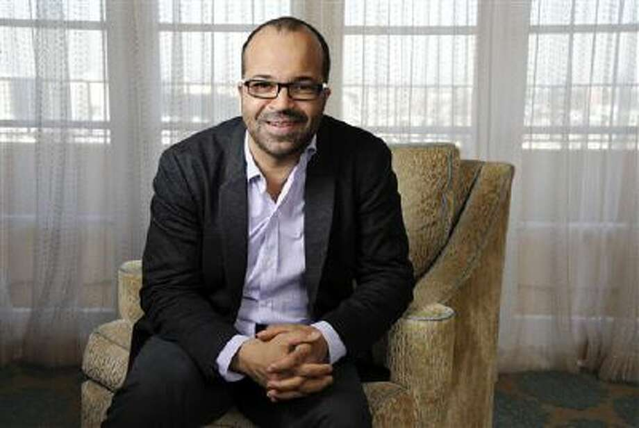 """In this Friday, Nov. 8, 2013 photo, Jeffrey Wright, a cast member in """"The Hunger Games: Catching Fire,"""" poses for a portrait at the Four Seasons Hotel in Beverly Hills, Calif. Wright is one of the most versatile African-American actors of his generation. With Broadway chops, an Emmy, Golden Globe, Tony and over 35 films under his belt, including the No. 1 movie ?The Hunger Games: Catching Fire,? the 47-year-old actor is far from a household name and he could care less. Photo: Chris Pizzello/Invision/AP / Invision"""