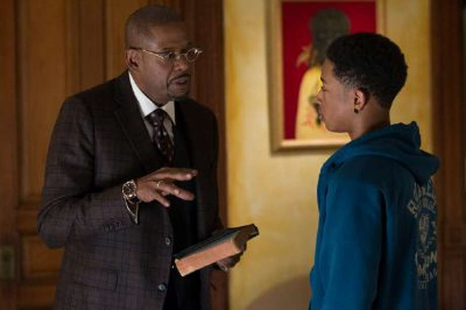 "This image released by Fox Searchlight Films shows Forest Whitaker, left, and Jacob Latimore in a scene from ""Black Nativity."" Photo: AP / Fox Searchlight Films net"