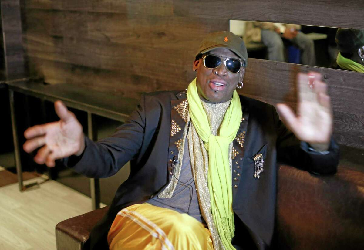"Dennis Rodman gestues during an interview after a promotional event to pitch a vodka brand in Chicago. Rodman looked fit and at ease, not squirming even once _ a childhood habit that earned the nickname ""The Worm."" AP Photo/Charles Rex Arbogast"