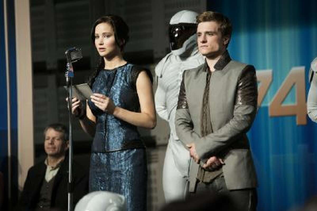 This publicity photo released by Lionsgate shows Jennifer Lawrence, left, as Katniss Everdeen and Josh Hutcherson as Peeta Mellark in a scene from the film,