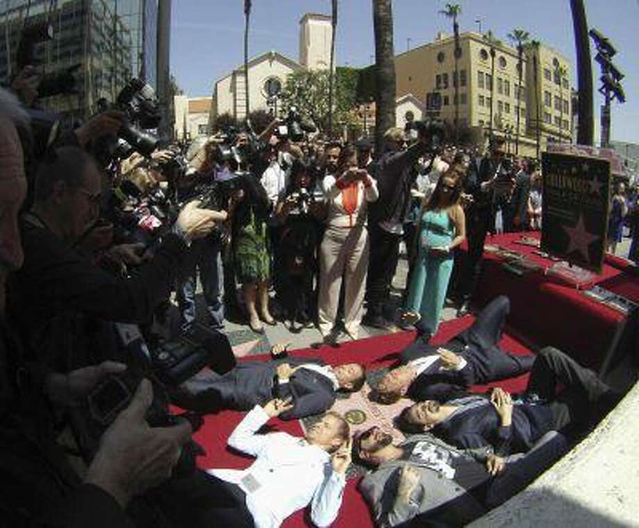 Backstreet Boys (from L, counterclockwise) Brian Littrell, A. J. McLean, Kevin Richardson, Nick Carter and Howie Dorough lie on their star after it was unveiled on the Walk of Fame in Los Angeles, California April 22, 2013. REUTERS/Mario Anzuoni (UNITED STATES - Tags: ENTERTAINMENT TPX IMAGES OF THE DAY) Photo: REUTERS / X90045