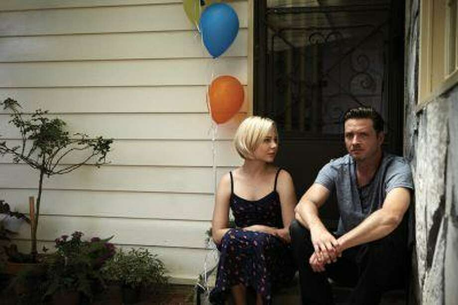 "This publicity image released by the Sundance Channel shows Adelaide Clemens, left, and Aden Young in a scene from the drama series ""Rectify."" The six-hour miniseries, whose first two hours air on Sundance Channel on Monday at 9 p.m., tells a unique story about a man who was caged for two decades for the rape and murder of his teenage girlfriend. Then, when his conviction is vacated thanks to new DNA evidence, he is restored to an outside world that proves just as harrowing. (AP Photo/Sundance Channel) Photo: AP / Sundance Channel"