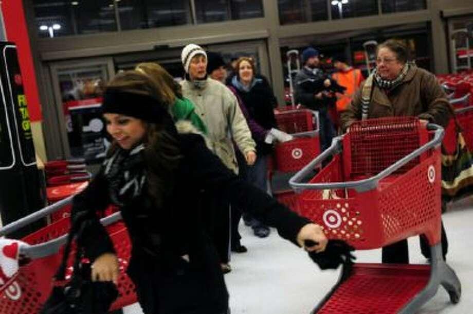 Shoppers rush into the Roseville Target store on Black Thursday, Thanksgiving night, to buy stuff for cheap, on November 22, 2012.