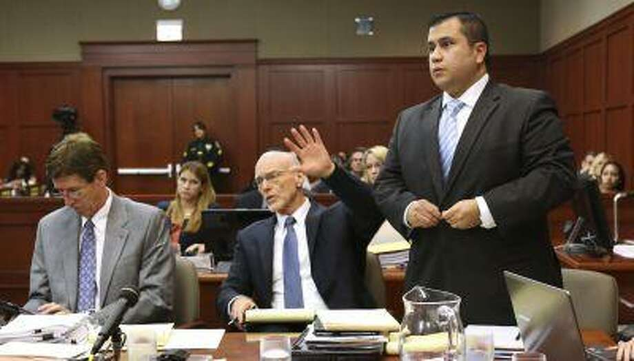 George Zimmerman stands next to his attorneys, Mark O'Mara (L), and Don West (C), to be identified by state witness Chris Serino, a Sanford police officer, in his second degree murder trial in Seminole circuit court in Sanford, Florida, July 1, 2013. (Joe Burbank/Reuters/Pool) Photo: REUTERS / X80003
