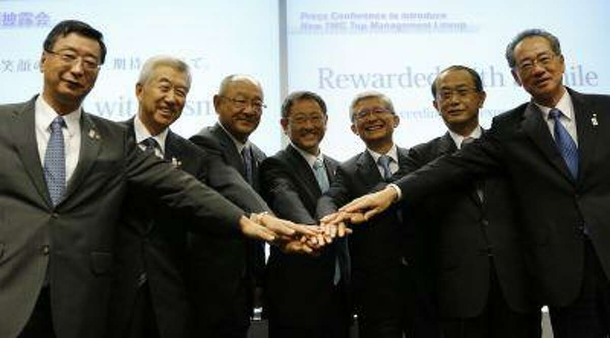 Toyota Motor Corp President Akio Toyoda (C) poses with executive vice presidents (L-R) Yasumori Ihara, Mitsuhisa Kato, Satoshi Ozawa, Toyoda, Nobuyori Kodaira, Masamoto Maekawa and Seiichi Sudo at a news conference to introduce the company's new top management line-up in Nagoya, central Japan July 1, 2013. Toyota Motor Corp executives have sometimes seemed to share the personality of the automaker's best-selling cars - dependable and efficient, but also a bit boring and bland. That's changing. In recent months, Toyoda has emerged from the bureaucratic shadows to present himself as the company's car-loving, fashion-forward salesman-in-chief. REUTERS/Toru Hanai (JAPAN - Tags: TRANSPORT BUSINESS)