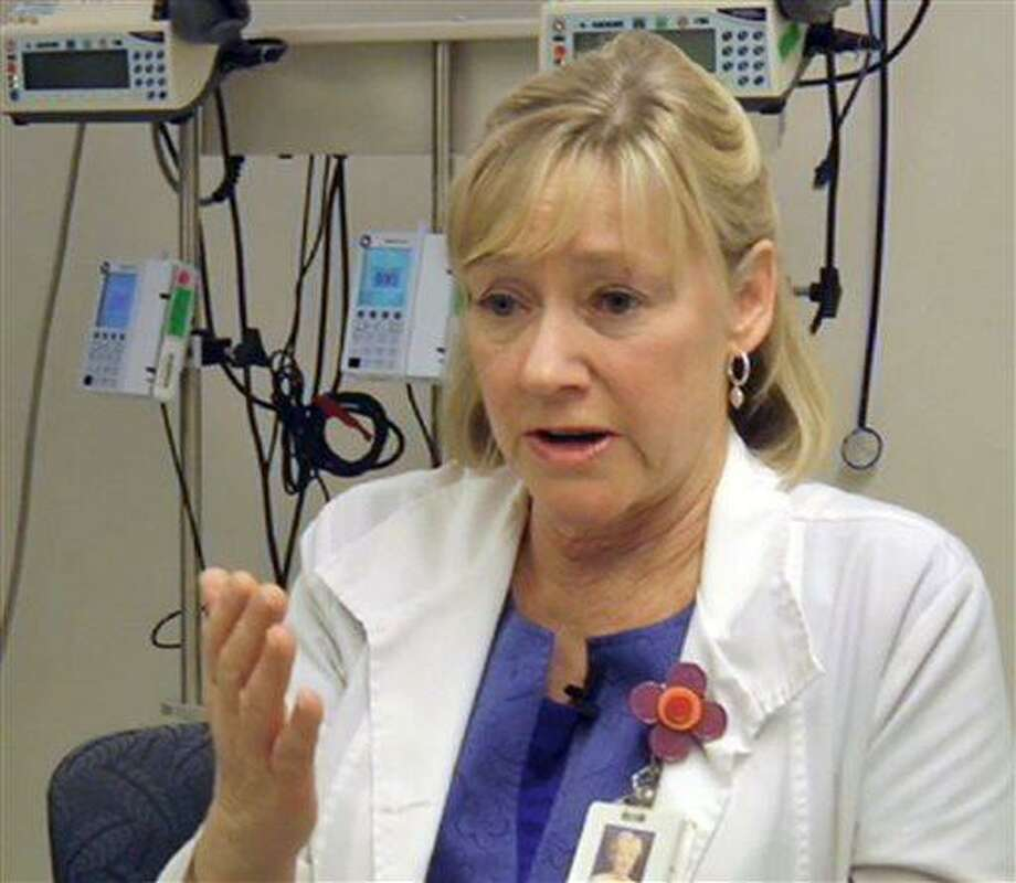 In this frame grab from Saturday, April 20, 2013, video, Massachusetts General Hospital nurse Jean Acquadra talks about the horrific early hours as bloody patients poured in after the explosions at the Boston Marathon. (AP Photo/Carla K. Johnson) Photo: AP / AP