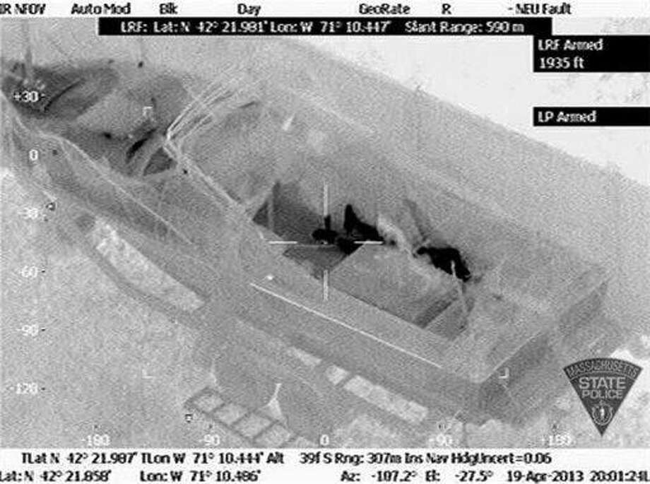 This Friday, April 19, 2013 image made available by the Massachusetts State Police shows 19-year-old Boston Marathon bombing suspect, Dzhokhar Tsarnaev, hiding inside a boat during a search for him in Watertown, Mass. He was pulled, wounded and bloody, from the boat parked in the backyard of a home in the Greater Boston area. (AP Photo/Massachusetts State Police) Photo: AP / Massachusetts State Police