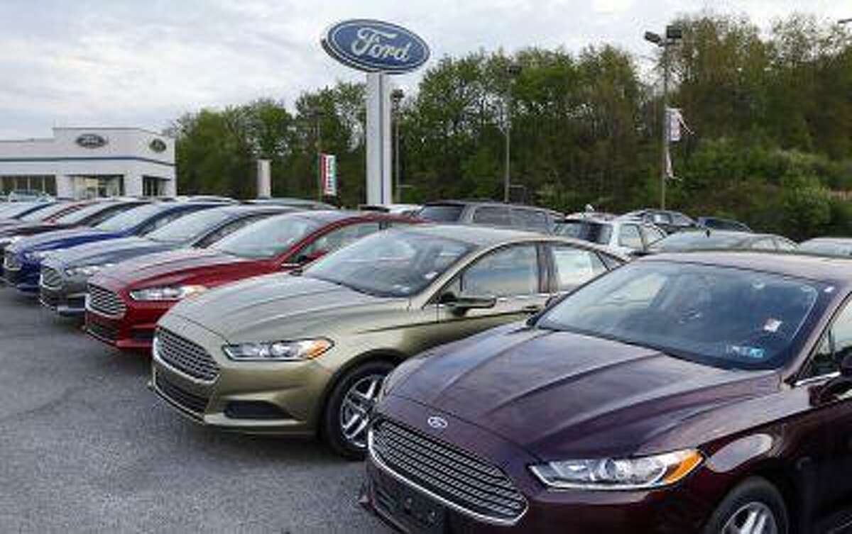 In this Wednesday, May 8, 2013 photo, new 2013 Ford Fusions are seen at an automobile dealer in Zelienople, Pa. Sales from the major automakers are expected to show that confident U.S. buyers snapped up new cars and trucks at a strong pace in June. (AP Photo/Keith Srakocic)