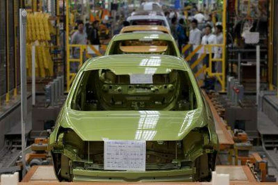 Partially built Ford Fiestas move down the assembly line at the Ford Motor Co. plant in Cuautitlan Izcalli, Mexico, in May 2010. A boom in auto manufacturing in Mexico is creating worries for U.S. auto workers about the long-term prospects for auto manufacturing jobs. (Bloomberg News/Susana Gonzalez)