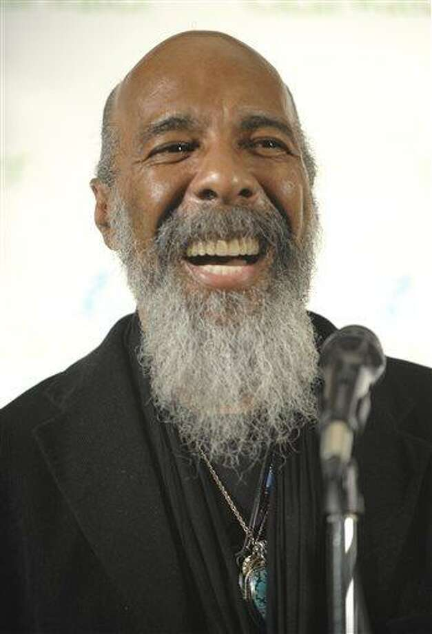 FILE - In this May 3, 2009 file photo, singer Richie Havens makes an appearance in the press room at the Clearwater Concert celebrating Pete Seeger's 90th birthday at Madison Square Garden, in New York. Havens, who sang and strummed for a sea of people at Woodstock, has died at 72. His family says in a statement that Havens died Monday, April 22, 2013, of a heart attack. (AP Photo/Peter Kramer, File) Photo: AP / AP