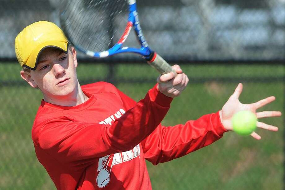 Catherine Avalone/The Middletown Press Portland junior first seed Alex Riccio defeated Coginchaug sophomore Garrett D'Amato 6-love, 6-2 Monday afternoon in Portland. Portland won the match, 6-1 against the Blue Devils. / TheMiddletownPress