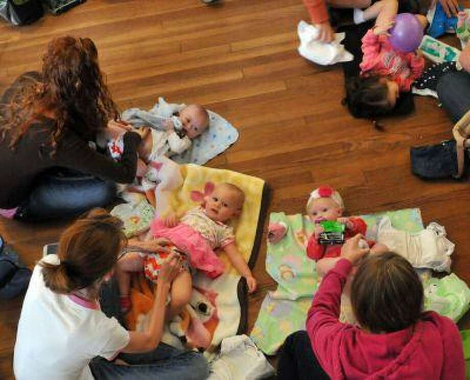 "Parents change their children during the ""Great Cloth Diaper Change"" Saturday morning April 20, 2013 during the Earth Day Festival Green Baby Expo at the American Legion in Savannah Georgia. Around 65 parents participated in the Guinness World Record attempt in Savannah, which was one of several participating locations around the world. (AP Photo/The Morning News, Richard Burkhart) THE <a href=""http://EXAMINER.COM"">EXAMINER.COM</a> OUT; <a href=""http://SFEXAMINER.COM"">SFEXAMINER.COM</a> OUT; <a href=""http://WASHINGTONEXAMINER.COM"">WASHINGTONEXAMINER.COM</a> OUT Photo: AP / SAVANNAH MORNING NEWS"