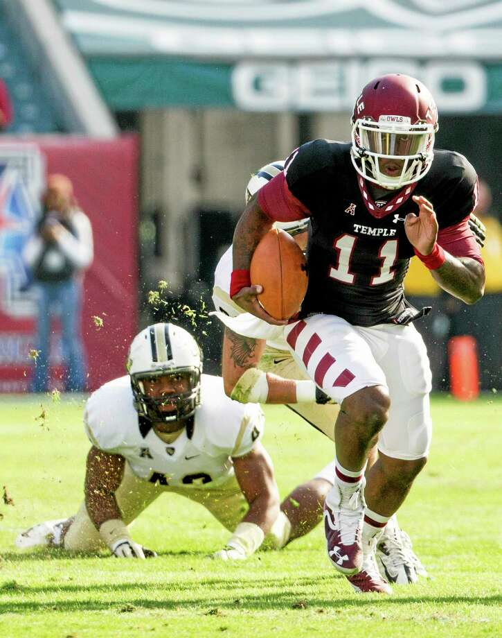 Temple quarterback P.J. Walker (11) scrambles as Central Florida linebacker Deondre Barnett hits the ground during last Saturday's game in Philadelphia. Photo: Chris Szagola — The Associated Press  / FR170982 AP