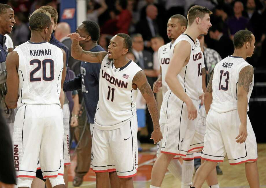 UConn's Ryan Boatright (11) celebrates with teammates after the 18th-ranked Huskies beat Indiana 59-58 Friday night at Madison Square Garden in New York. Photo: Seth Wenig — The Associated Press  / AP