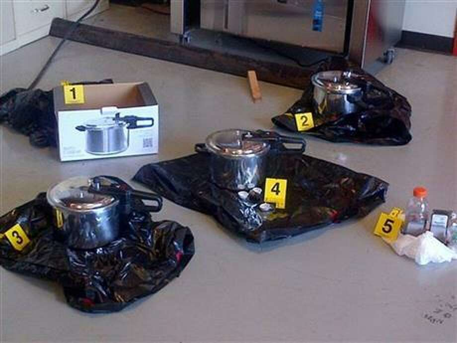 This evidence photo released by the Royal Canadian Mounted Police on July 2, 2013 shows three pressure cookers recovered outside the British Columbia's provincial legislature building before crowds gathered for Canada Day celebrations on Monday. On Monday, police arrested John Stewart Nuttall and Amanda Marie Korody and charged them with conspiracy, facilitating a terrorist activity and making an explosive device. (AP Photo/The Canadian Press, Royal Canadian Mounted Police)