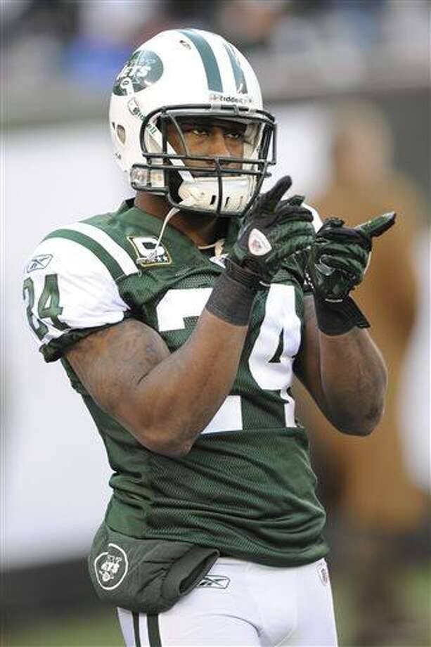 File-This Dec. 24, 2011 file photo shows New York Jets' Darrelle Revis pointing before an NFL football game between the New York Giants and the New York Jets in East Rutherford, N.J.  The Jets have traded Revis to the Buccaneers for this year's No. 13 overall draft pick and another selection next year.  (AP Photo/Bill Kostroun, File) Photo: AP / FR51951 AP