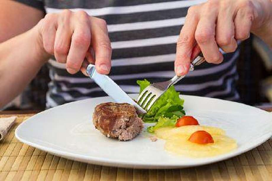 Does your fork switch hands after cutting? (iStockPhoto)