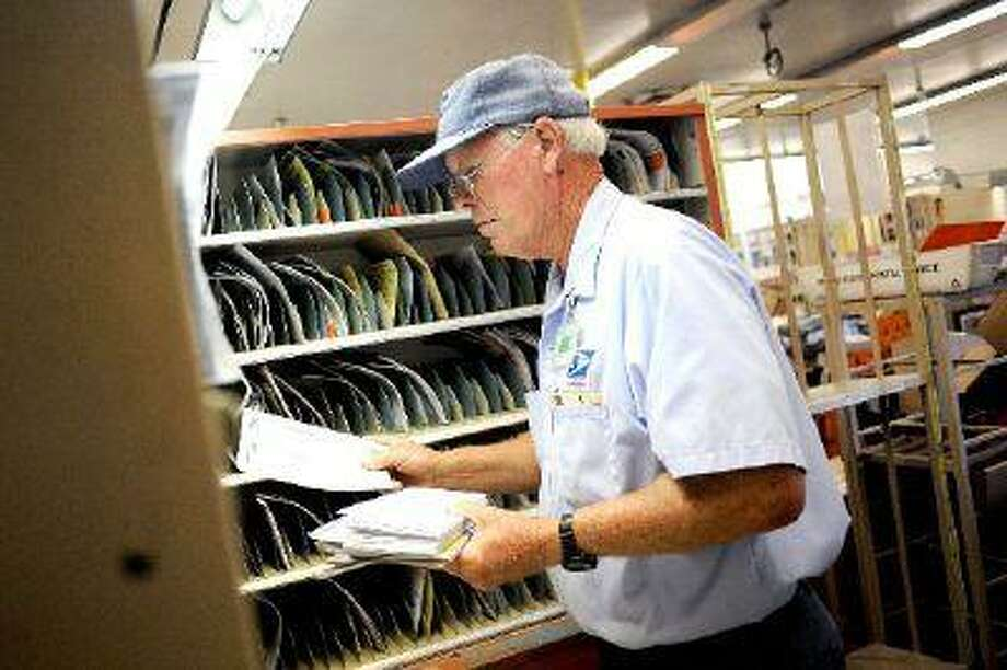 Letter carrier Robert Golden sorts mail at the Mission Hills USPS Annex Friday, June 28, 2013. Monday will mark the 50th anniversary of the so-called Zoning Improvement Plan that led to the use of ZIP codes on mail. (Andy Holzman/Los Angeles Daily News) / Los Angeles Daily News