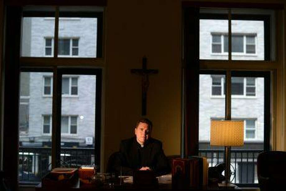 "Rev. Matt Malone is editor of America magazine, a favorite of Catholic liberal intellectuals. Malone, shown in his New York office on June 27, talks about why the publication is shifting course and will stop using the words ""liberal"" and ""conservative"" to describe Catholics' religious viewpoints. (Jennifer S. Altman/for The Washington Post)"
