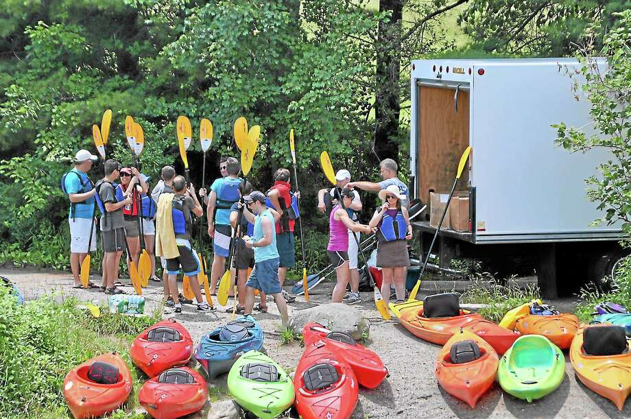 Students from Pomperaug High School in Southbury ready to take their kayaks out. The program could be coming to Middlesex County schools in the near future (submitted photo) Photo: Journal Register Co.