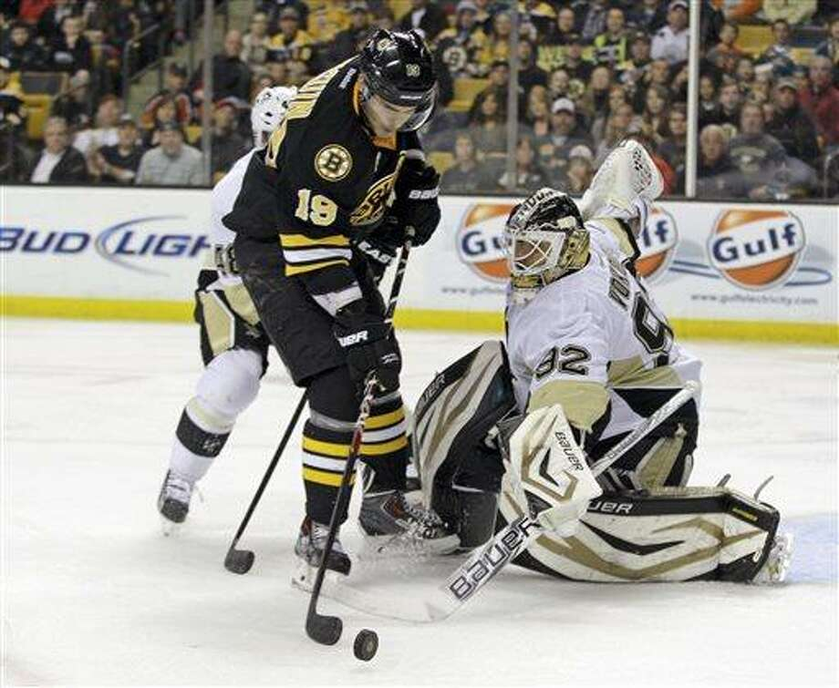 Pittsburgh Penguins goalie Tomas Vokoun (92) makes a stick save on a shot attempt by Boston Bruins center Tyler Seguin (19) during the second period of an NHL hockey game Saturday, April 20, 2013, in Boston.  (AP Photo/Mary Schwalm) Photo: ASSOCIATED PRESS / AP2013