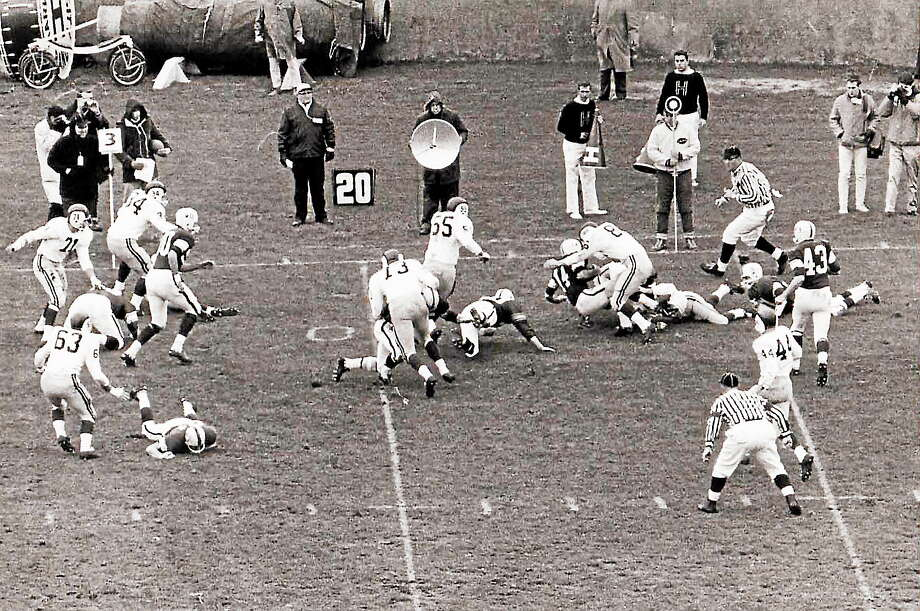 "After ""The Game,"" originally scheduled for Nov. 23, 1963, was postponed following the assassination of President John F. Kennedy, Yale and Harvard eventually played at the Yale Bowl on Nov. 30, 1963. The Elis won 20-6. Photo: Photo Courtesy Of Yale Athletics"