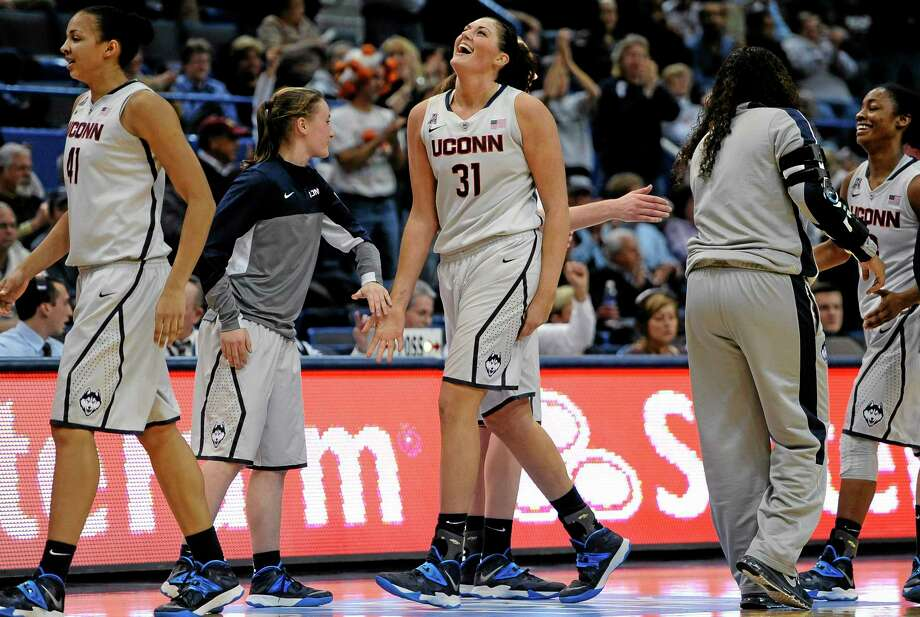 UConn's Stefanie Dolson walks to the bench during a timeout in the second half of Wednesday's game against Oregon in Hartford. Dolson finished the game with 26 points, 14 rebounds and 11 assists for the second triple-double in UConn's history. Photo: Jessica Hill — The Associated Press  / FR125654 AP