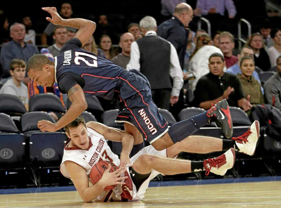 Boston College's Alex Dragicevich, bottom fights for a loose ball with UConn's Omar Calhoun during the first half on Thursday. Photo: Seth Wenig — The Associated Press  / AP