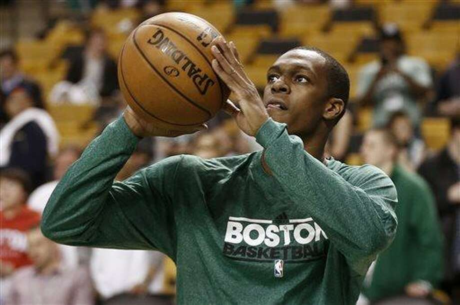 Injured Boston Celtics point guard Rajon Rondo shoots baskets before Game 3 of a first-round NBA basketball playoff series against the New York Knicks in Boston, Friday, April 26, 2013. (AP Photo/Winslow Townson) Photo: AP / FR170221 AP