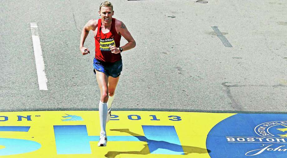 Jason Hartmann finished fourth at the Boston Marathon this past April. Photo: Charles Krupa — The Associated Press  / AP2013