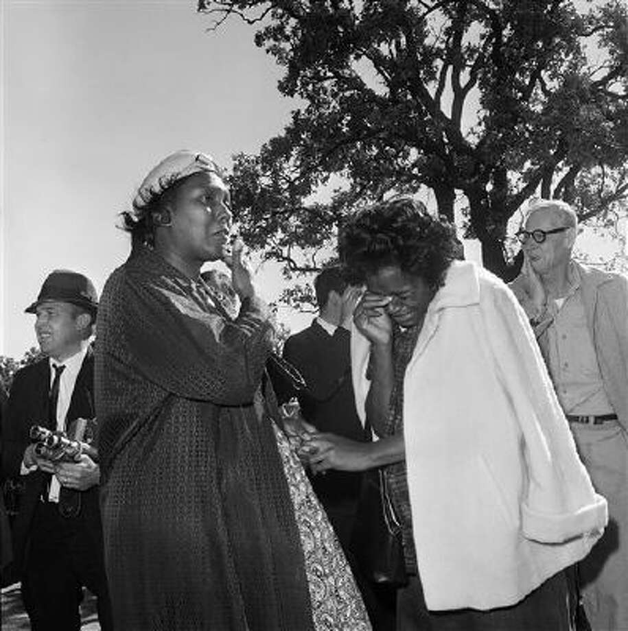 Women burst into tears Nov. 22, 1963, outside Parkland Hospital upon hearing that President John F. Kennedy died from a shooting while riding in a motorcade in Dallas. Photo: ASSOCIATED PRESS / THE ASSOCIATED PRESS2013