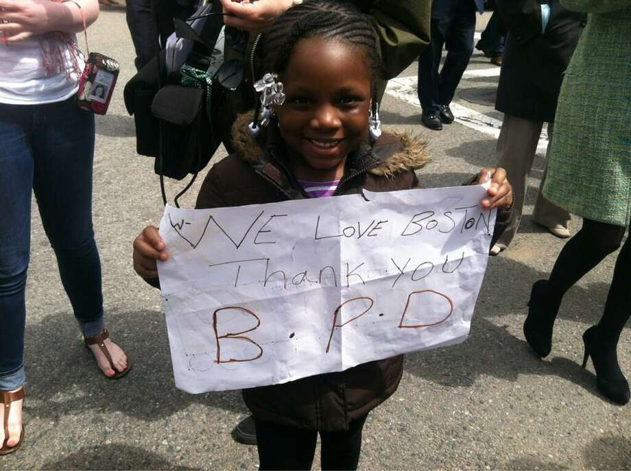 Saran Fofana, 5, thanks the Boston Police Department. Jennifer Swift/Register