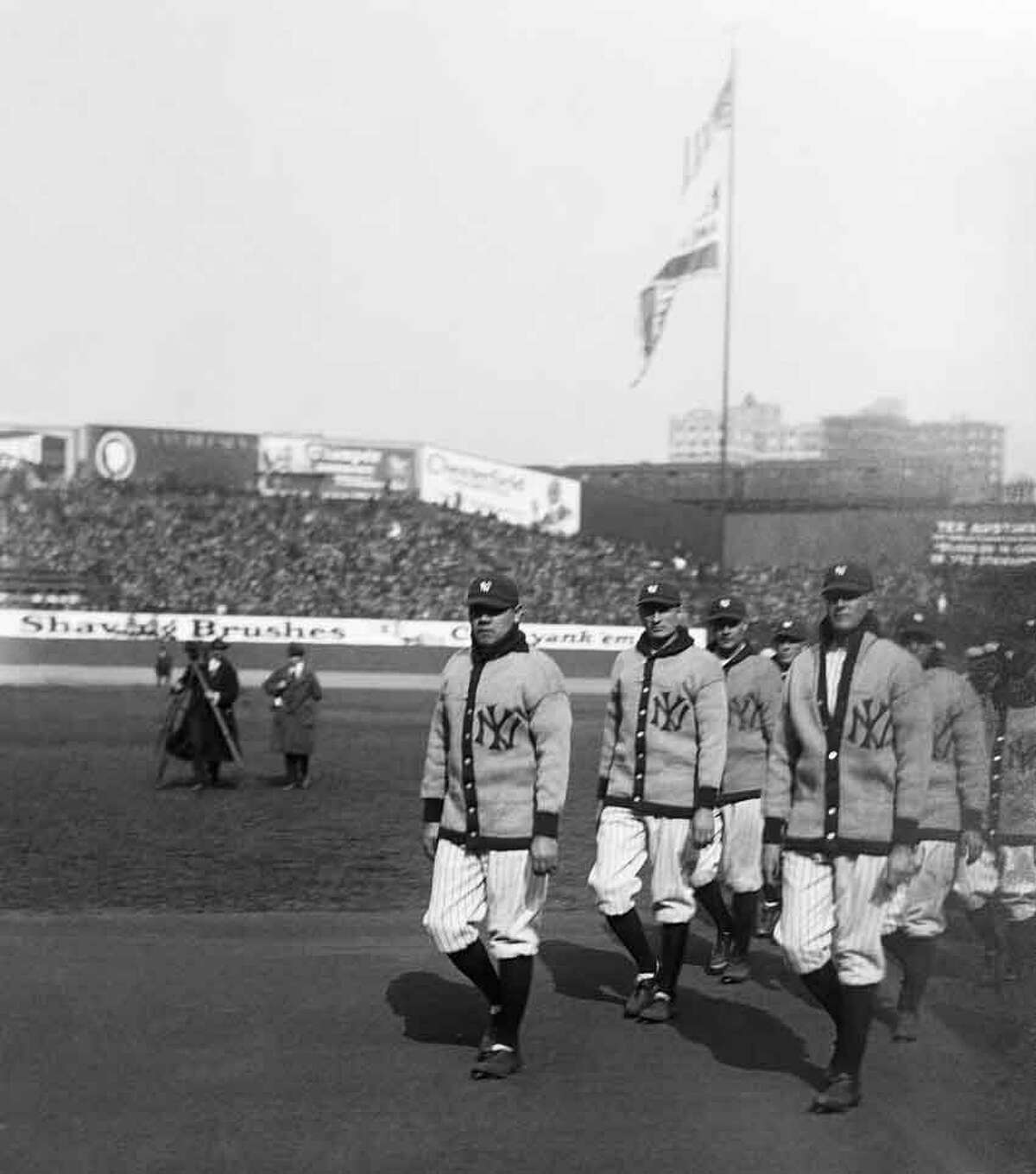 Babe Ruth, left, leads the New York Yankees onto the field for their first game at Yankee Stadium, April 18, 1923. Appropriately, the Bambino christened the stadium with its first home run as the Yankees beat the Boston Red Sox 4-1. It's no secret that Yankee Stadium's dimensions suited Ruth's left-handed power. As generations of lefties would do after him, the Babe took full advantage of the short right field poweralley and foul line. The right field foul pole stood just 295 feet from home plate. The left field pole was even shorter at 281 feet, but the bulging expanse of leftcenter field earned its nickname as
