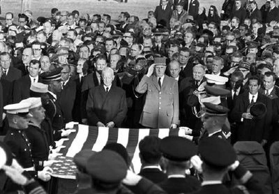 President Charles de Gaulle of France, center, and other dignitaries salute as servicemen hold an American flag above the casket of President John F. Kennedy in Arlington National Cemetery in Arlington, Va., on Nov. 25, 1963. Photo: AP / AP