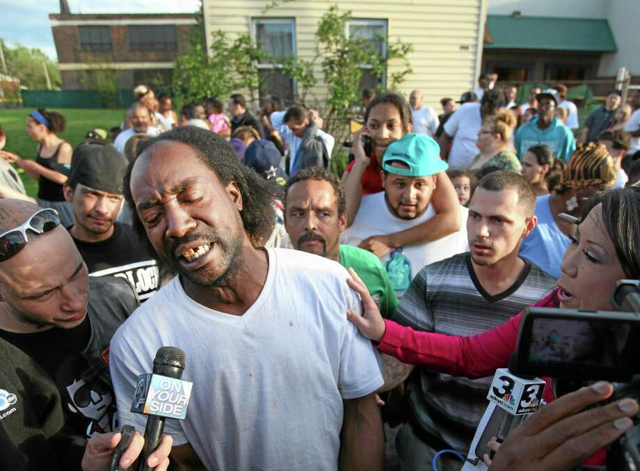 Charles Ramsey speaks with reporters in Cleveland. (The Associated Press /The Plain Dealer, Scott Shaw) Photo: AP / The Plain Dealer