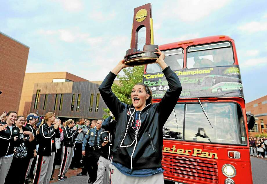 UConn's Stefanie Dolson carries the trophy during a parade through campus honoring the team's win in the women's NCAA Final Four college basketball championship. Photo: Jessica Hill  — The Associated Press  / A2013