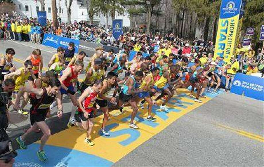 The elite men start the 117th running of the Boston Marathon, in Hopkinton, Mass., Monday. Many runners whose times have not been good enough to compete in Boston now say they will work hard to qualify, as a way to honor this year's bombing victims. Photo: AP / FR56276 AP