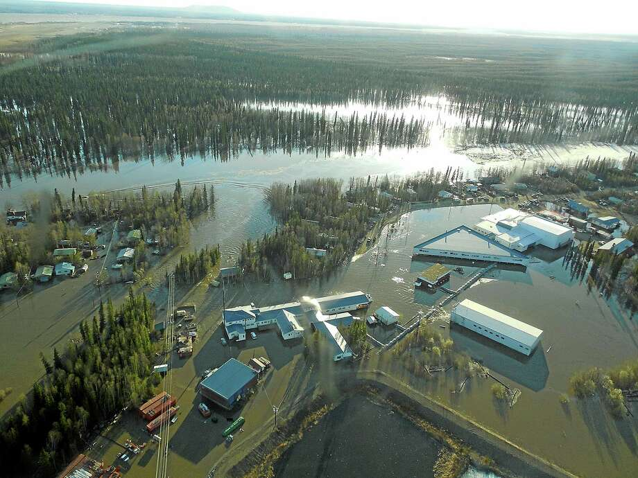 Locations like Galena, Alaska, were already weakened by flooding earlier this summer from melting ice in the Yukon River. (AP Photo/National Meteorological Service, Ed Plumb) Photo: AP / National Weather Service