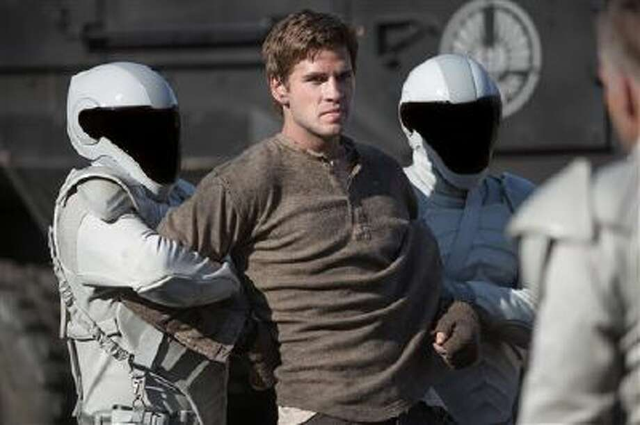 "This image released by Lionsgate shows Liam Hemsworth as Gale Hawthorne in a scene from ""The Hunger Games: Catching Fire."" Photo: AP / Lionsgate"