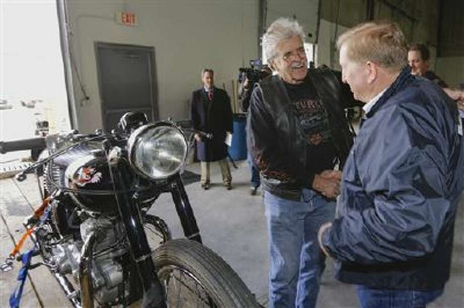 Donald DeVault, center, thanks Lou Koven, an investigator with the National Insurance Crime Bureau in Los Angeles, in Omaha, Neb. It was the first time DeVault had seen the bike since it was stolen from him 46 years ago. California authorities, including Koven, had recovered his 1953 Triumph Tiger 100 at the Port of Los Angeles where it was about to be shipped to Japan. Photo: AP / AP