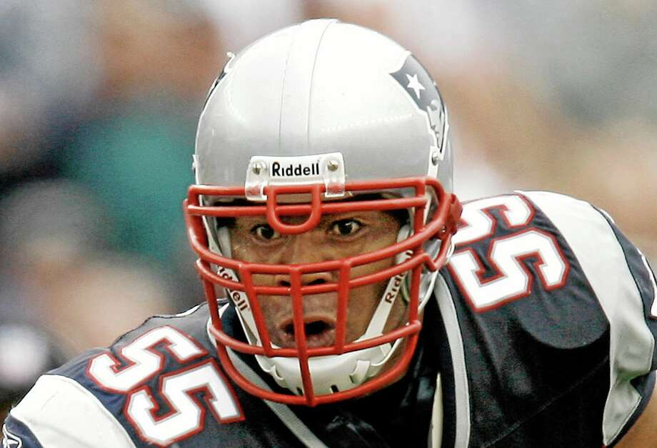 In this Oct. 7, 2007 file photo, New England Patriots linebacker Junior Seau runs with the ball after an interception. Senior U.S. District Judge Anita Brody in Philadelphia announced Thursday that the NFL and more than 4,500 former players want to settle concussion-related lawsuits for $765 million. The plaintiffs include at least 10 members of the Pro Football Hall of Fame, along with and the family of Seau, who committed suicide last year. The global settlement would fund medical exams, concussion-related compensation and medical research. Photo: Winslow Townson — The Associated Press File Photo  / AP