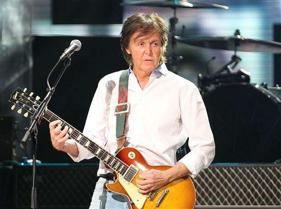 FILE - This Dec. 12, 2012 file image released by Starpix shows Paul McCartney at the 12-12-12 The Concert for Sandy Relief at Madison Square Garden in New York.  McCartney is adding his voice to Tony Bennett's campaign against gun violence. The former Beatle recorded a voice message that's part of a text-to-call operation Wednesday, April 17, 2013, for Bennett's Voices Against Violence campaign. McCartney and others are encouraging Americans to send a text, which will lead to the singer's message and connect the caller to their local senate office after proving their zip code. (AP Photo/Starpix, Dave Allocca, file) Photo: AP / STARPIX